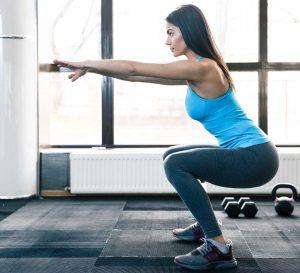 woman squatting with proper squat form - CrossFit Technique